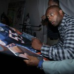 Lance Briggs Signing an original Painting by Rob Jackson